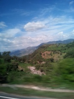 View from the bus through Guatemala. Every mile you travel costs. Spending more time in fewer places can save big money.