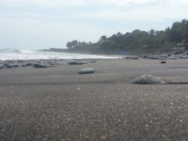 Rocky, black beaches that sparkle